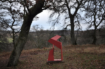 Red sculpture and a view to the hills