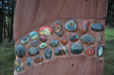 Each inset painted pebble is different