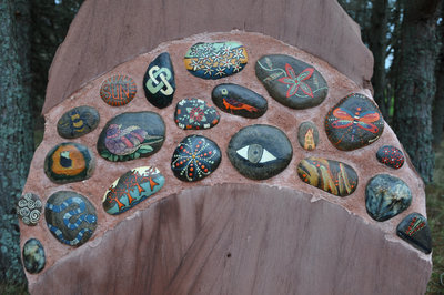 Poetry Path painted pebbles set in stone